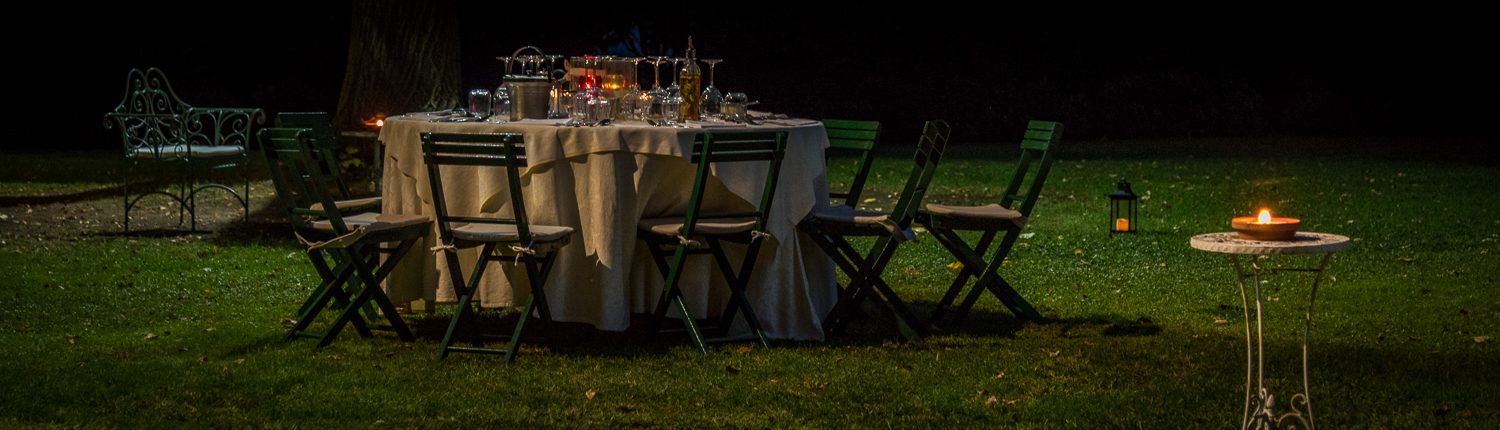 in a Tuscan garden - romantic candle light dinner in italy