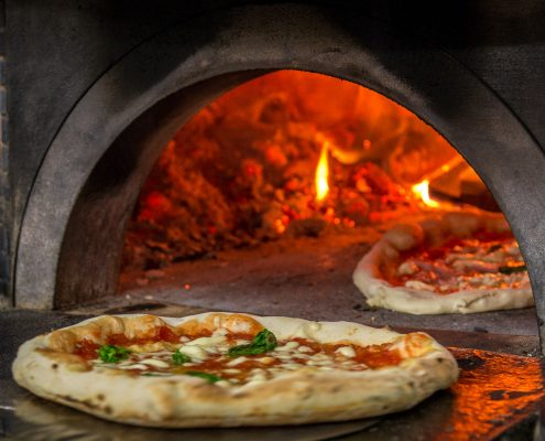 real pizza baked in the stone oven in naples, food and wine experiences in Italy